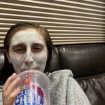 Megan drinking slushy and wearing face mask