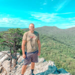 man standing on top of mountain North Carolina