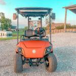 Orange Yamaha golf cart