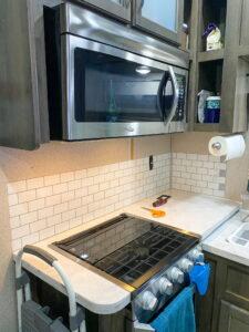Adding peel and stick tiles as kitchen backsplash