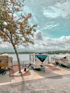 RV's lined up in front of lake