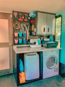 RV Toyhauler washer/dryer and pegboard storage