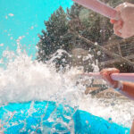 Water splashing into raft