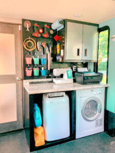 RV Toy Hauler Garage with washer and pegboard organization