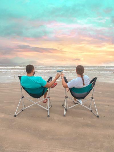 Couple drinking coffee on the beach
