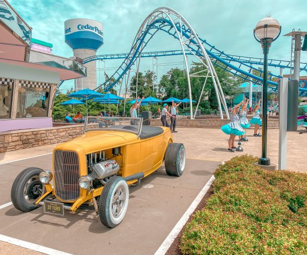 Performers at Cedar point outside of diner with old fashioned car