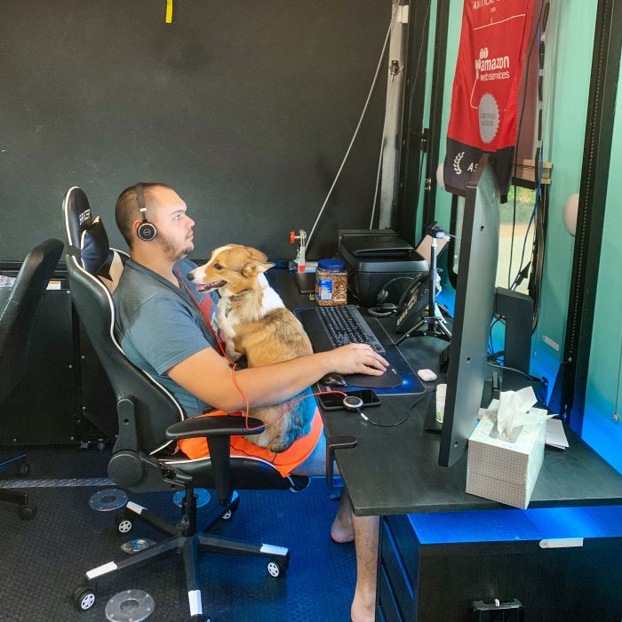 Man sitting at desk with dog working
