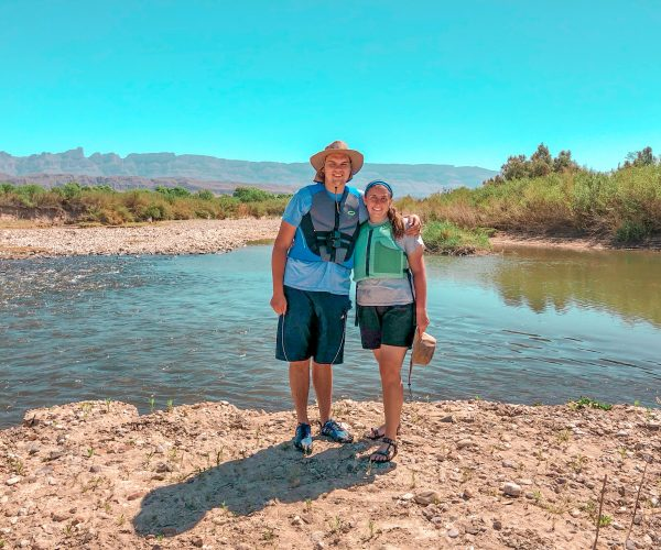 Couple standing in front of Rio Grande river