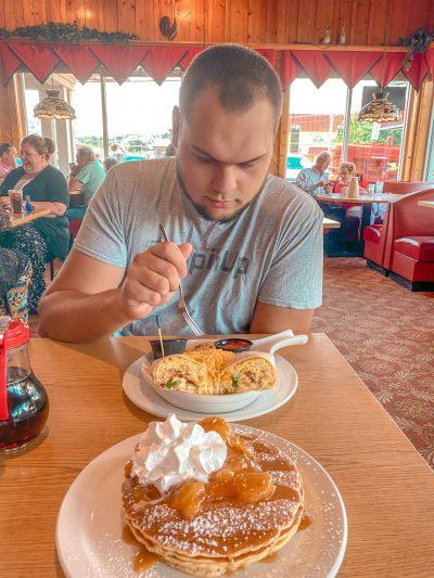 Eating breakfast: pancakes and breakfast burrito