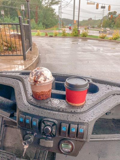 coffee in cup holders on golf cart