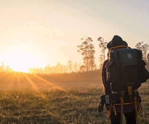 Hiker / backpacker looking at the sunrise