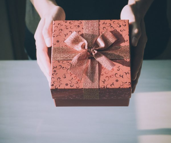 woman holding present with bow
