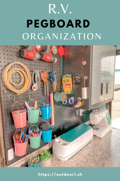 craft supplies on pegboard organization